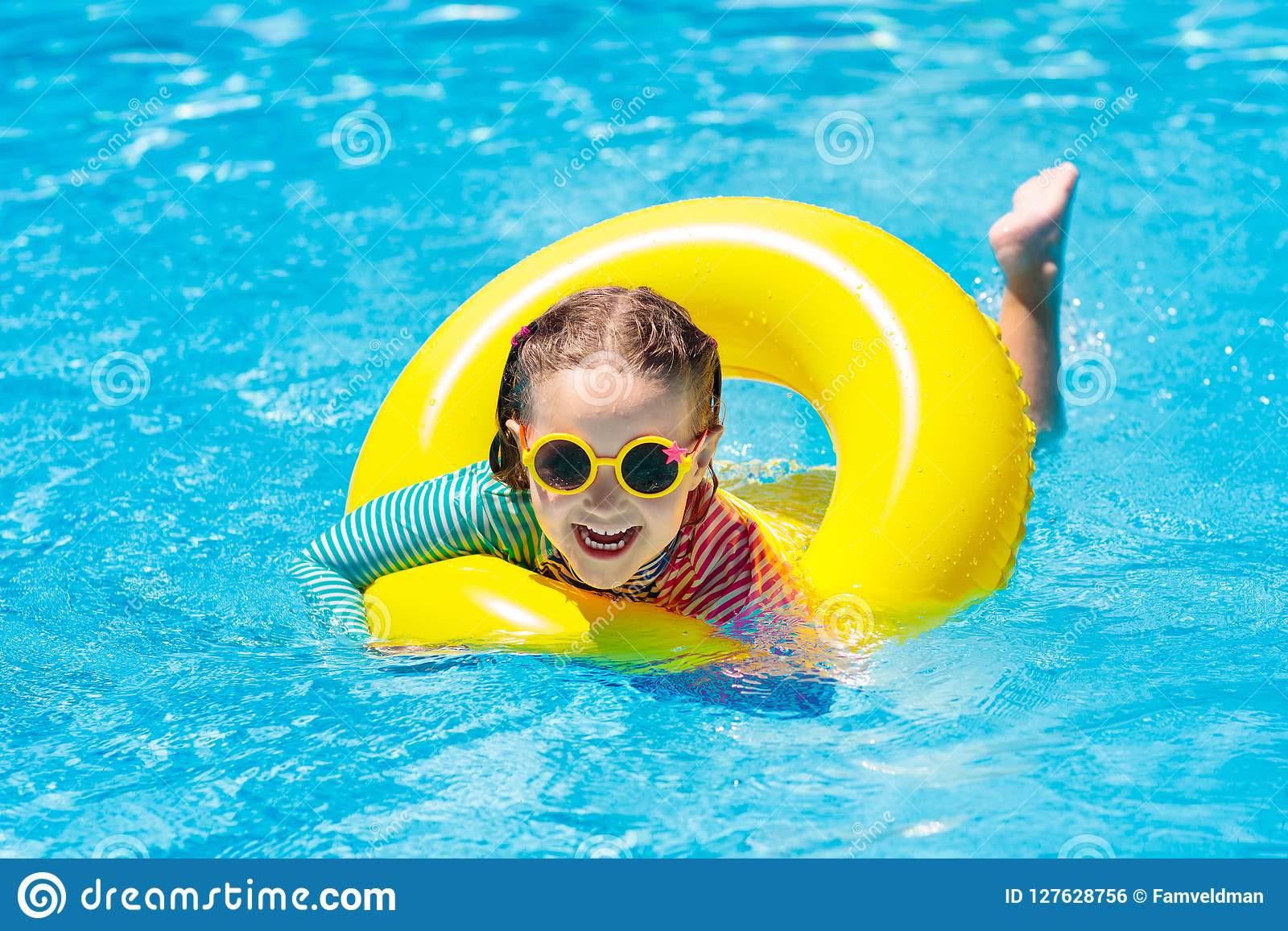 Kids Outdoor Swimming Pool  Child In Swimming Pool Kids Swim Water Play Stock