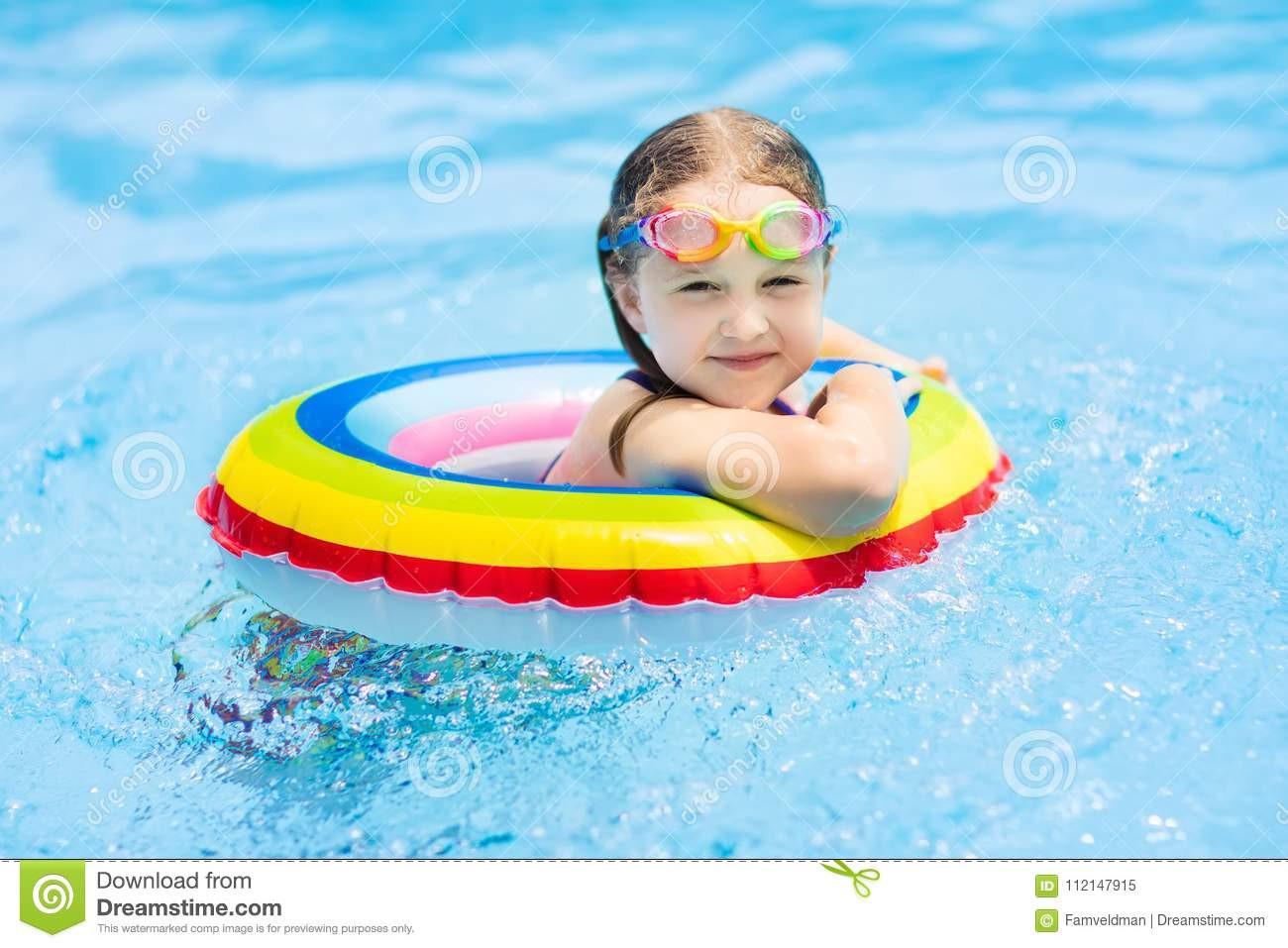 Kids Outdoor Swimming Pool  Child In Swimming Pool Kids Swim Water Play Stock Image